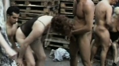 Mature ladies in a gangbang getting some good old fashioned cunt pounding