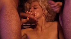 Beautiful blonde in white stockings gets double penetrated on the bed