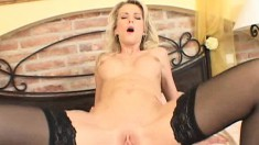 Gorgeous blonde in black stockings Katia has a passion for anal action