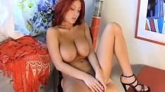 Fiery redhead with wonderful big hooters Ashley Robbins fucks a dildo