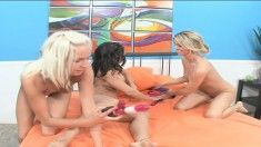 Striking Marlie Moore and her lesbian friends have fun with sex toys
