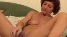 Sweet redhead Frederica slides a dildo in and out of her juicy peach