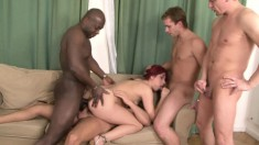 Naughty redhead gets gangbanged and swallows a huge load of hot semen