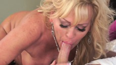 Big breasted blonde granny has a young man fulfilling her sexual urges