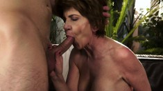 Buxom mature buries a huge dildo and a hard cock deep inside her cunt