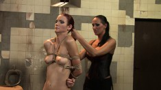 Big breasted mistress Mandy enjoys her time with her new slave Lucy
