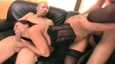 Ravishing redhead cougar in black lingerie gets drilled by two guys