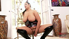 The exotic brunette with huge boobs, cums hard on her fake cock