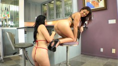 Two busty lesbian lovers fucking each other with a double-ended dildo