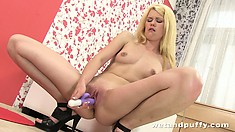The vibrating dildo works magic in her pumped up pussy in this hot solo