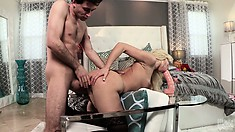 Stretching her tight cunt with a huge dildo, the blonde paves the way for a big cock