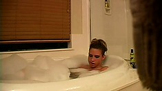 Gorgeous teen soaks her barely legal body in a hot bubble bath