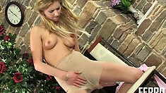 Lustful blonde milf with sexy legs Gertie pleases herself with her fingers and a dildo