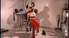 Wild redheaded dominatrix ties up and punishes her naughty female slave