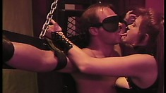 Mistress Tara ties up her slave to torture and gives him blue balls