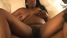 Chubby chocolate girl gets wet as she fucks her girlfriend with a dildo
