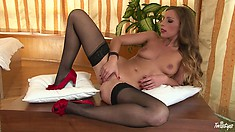 Pretty black stocking girl finds where she could stick her fingers