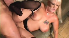 Busty blonde in stockings bangs an older man while her bf watches