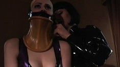 Rude Mistress puts her maid into tight latex and dominates her