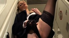 Horny couple fucking in the lavatory of an airplane while stewardess jills off