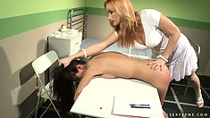 She lays her on the table, naked, and starts spanking her ass