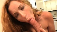 A redhead cocksucker runs her tongue all over this long pole