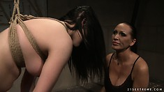 Naughty brunette slave is tied up and bent over and at the mistress' mercy