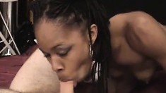 Ebony hottie gently fingers her cunt and then sucks a white rod in POV