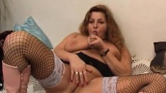 Curvy mature lady in sexy lingerie makes herself cum with a big dildo