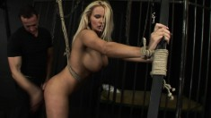 Sexy young blonde gets her juicy ass spanked while being tied up