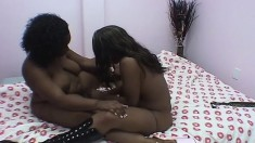 Dark skinned lesbians with fabulous big booties making each other cum