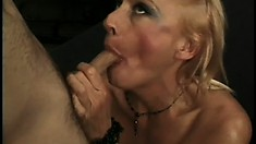 Lustful blonde lady with big tits seizes the chance to have her lips around a big dick