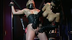 Anna Mills is bound so she can't move and is teased by her master