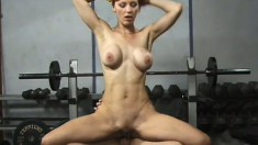 Athletic redhead with big round tits gets double penetrated in the gym